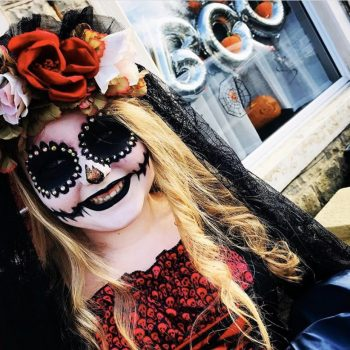 This is a photograph of a day of the dead/Dia De Los Muertos sugar skull makeup look created by DootsyBeauty using Veil Cover Cream as a base for the look for Halloween.