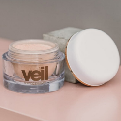 This is an image of Veil Finishing Powder, a finely milled product designed to set makeup in place, eliminate shine and increase wear time.