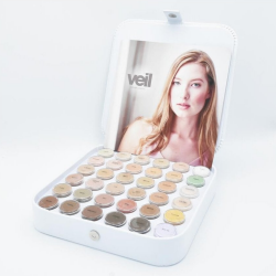 This is an image of the Veil Cover Cream Professional Kit, a makeup product featuring a large variety of different concealer shades to match a variety of different skin tones.